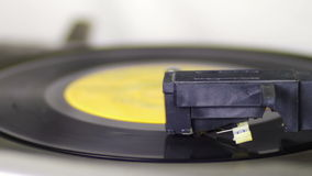 Turntable With Spinning Vinyl. Macro shot of old vinyl recording rotating in vintage player. Good for record player, gramophone, party, DJ, music, and more stock footage