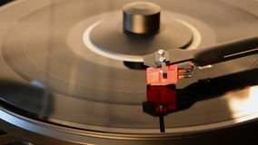 Turntable With Spinning Vinyl Record. A clean macro capture of a modern turntable playing a vinyl record stock video
