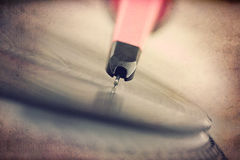 Turntable with spinning vinyl record, grunge background Royalty Free Stock Photography