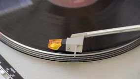 Turntable Start. High quality turntable, headshell and needle close-up, with professional light stock video