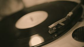 Turntable stylus closeup, retro music playing on vinyl record, sound equipment. Stock footage stock footage