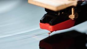 Turntable stylus macro. Closeup footage of vintage playing turntable with focus on stylus stock video footage