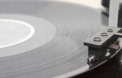 Turntable with stylus running along a vinyl record Royalty Free Stock Photography