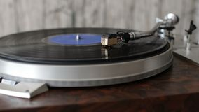 Turntable with stylus running along a vinyl record. Turntable vinyl record player. Included gramophone and torque plate close-up stock footage