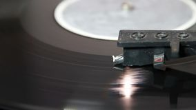 Turntable with stylus running along a vinyl. Record stock video footage
