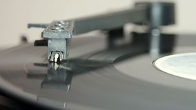 Turntable with stylus running a vinyl record. Turntable with stylus running along a vinyl record stock video footage