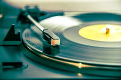 Turntable and vinyl. Turntable system playing a vinyl record royalty free stock photography
