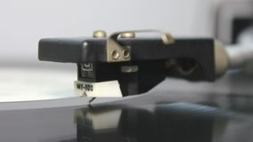 Turntable. An ultra extreme close up of a turntable stylus being put on a vinyl record stock video footage