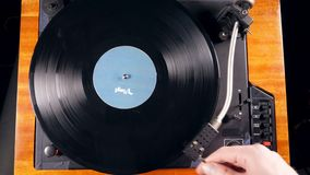 Turntable with a vinyl disc is getting launched. 4K stock video footage
