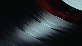 Turntable vinyl disc with label spinning closeup macro. Turntable vinyl disc with label spinning closeup macro stock video footage