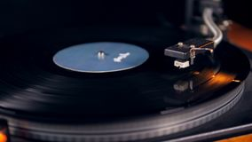 Turntable with a vinyl disc stops playing. 4K stock footage