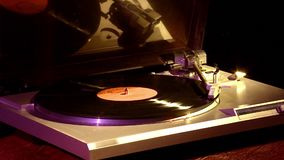 Turntable for vinyl discs. The vinyl record is played on the player