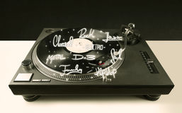 Turntable with vinyl and music genres writen. Concept on background royalty free stock photography