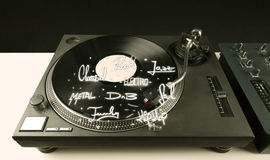 Turntable with vinyl and music genres writen. Concept on background royalty free stock image