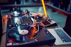 Turntable, vinyl record at night club. blured background. royalty free stock photography