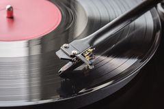Close up,focus on needle cartridge headshell.Hifi sound system. Turntable vinyl record player on background of sunset over. Sound technology for DJ to mix & play royalty free stock photo