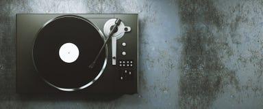Vinyl record player on concrete background Royalty Free Stock Photos