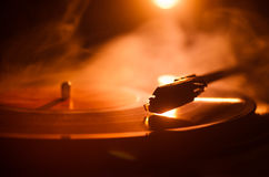 Turntable vinyl record player. Retro audio equipment for disc jockey. Sound technology for DJ to mix & play music. Vinyl record be Royalty Free Stock Photo