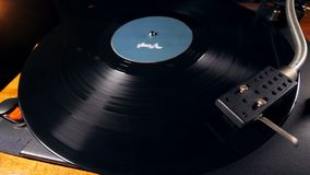 Turntable with a vinyl record spinning along it. 4K stock video