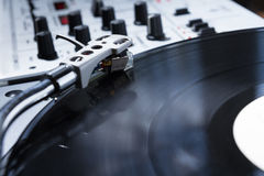 Turntable, vinyl and sound mixer Royalty Free Stock Photography