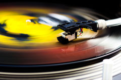 Turntable and vinyl. Tonearm on a spinning color picture vinyl Stock Photos