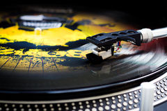 Turntable and vinyl. Tonearm on a spinning color picture vinyl Royalty Free Stock Photo