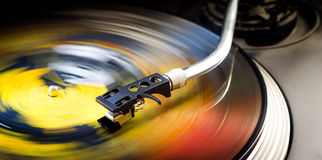 Turntable and vinyl. Tonearm on a spinning color picture vinyl Stock Photo
