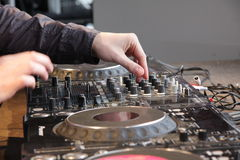 Turntables 1615. Multiple digital turntables and mixing equipment. Hands of the DJ. Available in RAW Stock Photography