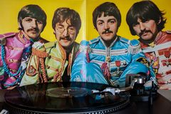 Turntables With The Beatles Vinyls In The Background. Royalty Free Stock Photos