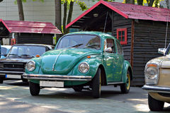 Turqoise or green Volkswagen Beetle. Parked at a classic car show in Municipal Park Parcul Municipal in Targu Mures, Romania Stock Images