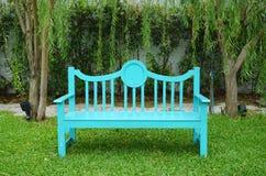 Turqouise color garden bench Stock Photos