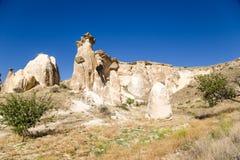Turquía, Cappadocia Parte de la ciudad de la cueva en las rocas alrededor de Cavusin Fotografía de archivo libre de regalías