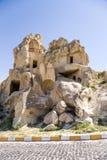 Turquia, Cappadocia As ruínas do monastério da caverna na rocha no museu do ar livre de Goreme Foto de Stock Royalty Free