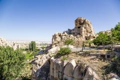 Turquia, Cappadocia Ruínas do monastério antigo da caverna no museu Goreme do ar livre das rochas Fotos de Stock