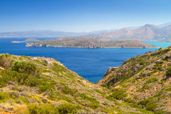 Mirabello bay with Spinalonga island. Turquise water of Mirabello bay with Spinalonga island on Crete Royalty Free Stock Photography