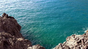 Turquois water at a rocky coast. Video clip stock video footage