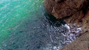 Turquois water at a rocky coast. Video clip stock footage