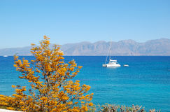 Turquoise Aegean Sea and luxury yacht Stock Photo