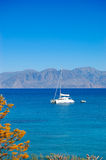 Turquoise Aegean Sea and luxury yacht Royalty Free Stock Photo