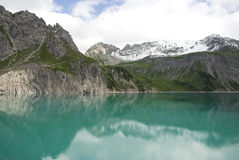 Turquoise alpine lake Stock Photo