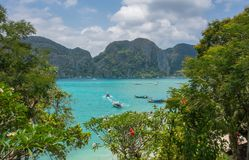 Turquoise Andaman sea and islands through green leaves. In Thailand royalty free stock images