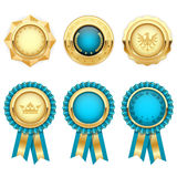 Turquoise award rosettes and gold medals Stock Photo