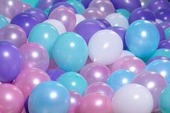 Turquoise background with balloons Stock Photos