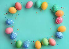 Turquoise background with colorful easter eggs. Happy Easter! Turquoise background with colorful easter eggs. Top view with copy space Royalty Free Stock Photography