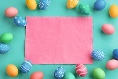Turquoise background with colorful easter eggs. Happy Easter! Turquoise background with colorful easter eggs. Top view with copy space Stock Photography