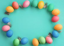 Turquoise background with colorful easter eggs. Happy Easter! Turquoise background with colorful easter eggs. Top view with copy space Royalty Free Stock Photos