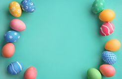 Turquoise background with colorful easter eggs. Happy Easter! Turquoise background with colorful easter eggs. Top view with copy space Stock Image