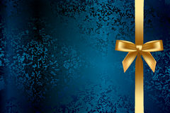 Turquoise background with gold bow Stock Photos