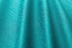 Turquoise background luxury cloth or wavy folds of grunge silk texture satin. Abstract background luxury cloth or liquid wave or wavy folds of grunge silk royalty free stock photo