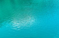 Free Turquoise Background Of Lake Water. Stock Images - 100149184